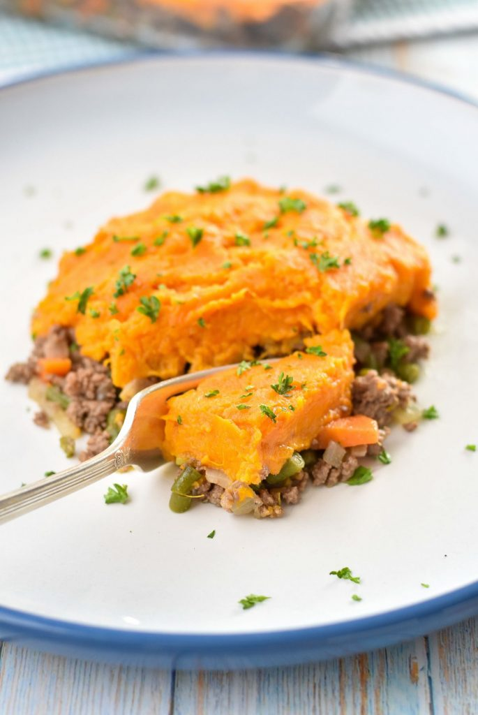 a fork cutting a piece of sweet potato shepherd's pie with a fork