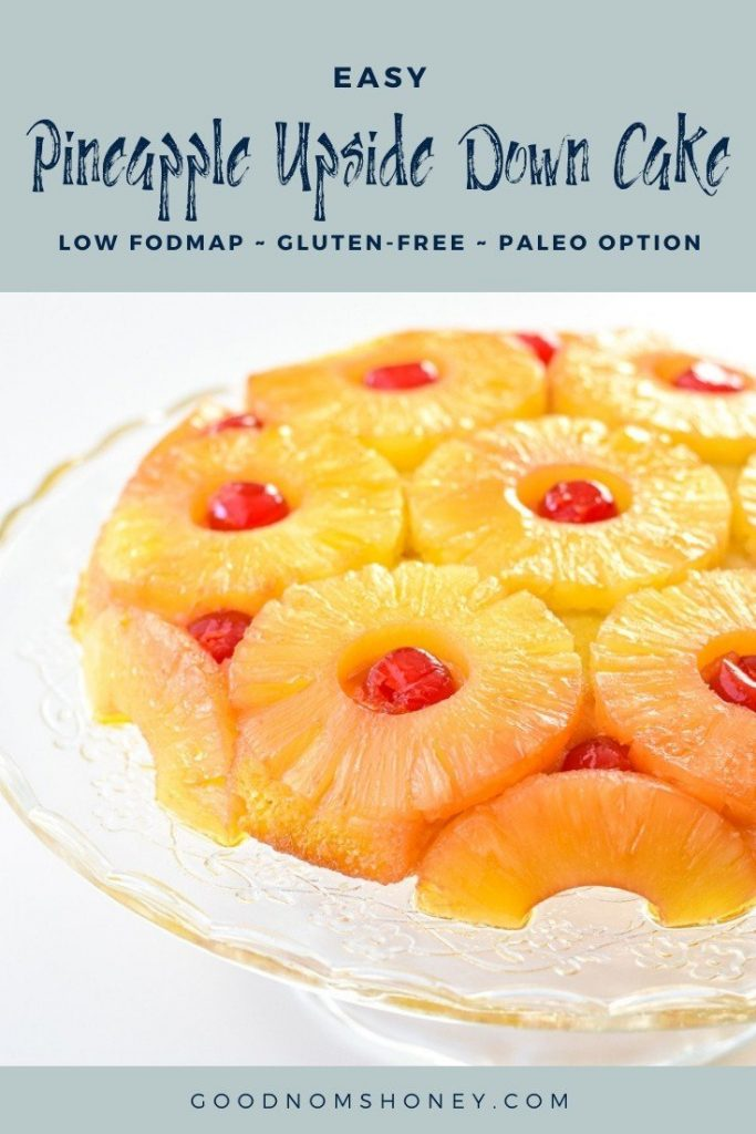 pineapple upside down cake on a cake stand with easy pineapple upside down cake low fodmap gluten-free paleo option written at the top and goodnomshoney.com at the bottom
