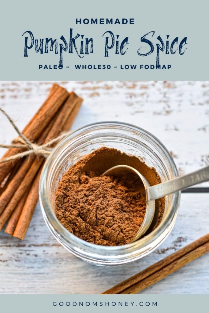 a spoon scooping spice mix with homemade pumpkin pie spice paleo whole30 low fodmap at the top and goodnomshoney.com at the bottom