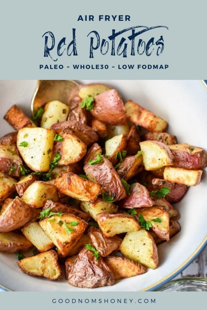 a bowl of red potatoes with air fryer red potatoes paleo whole30 low fodmap at the top and goodnomshoney.com at the bottom